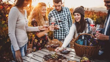 Five-people-laughing-toasting-enjoying-wine-culinary-delights